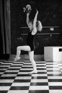 Pre-school dancer holding flowers